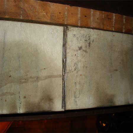 Heat ductwork covered in asbestos paper