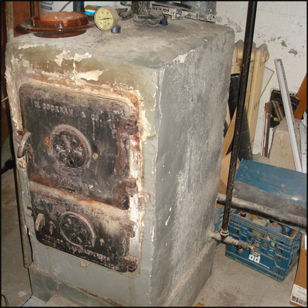 Painted asbestos covered boiler.