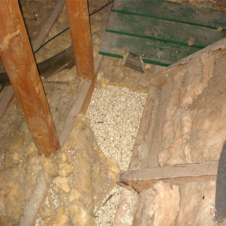 Asbestos containing Vermiculite covered by fiberglass.