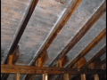 Mold stained attic with ice dams.